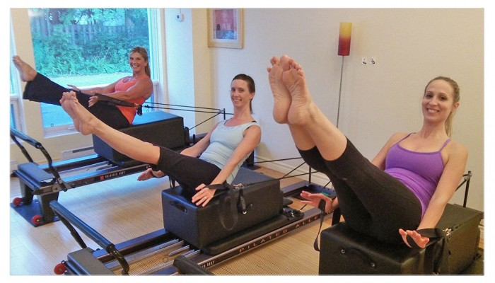 Pilates class on reformer